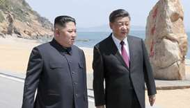 Chinese President Xi Jinping and North Korean leader Kim Jong Un meet in Dalian