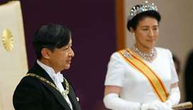 Japan's Emperor Naruhito, flanked by Empress Masako