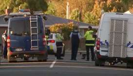 Police officers and vehicles are seen behind police cordon, in Christchurch, New Zealand