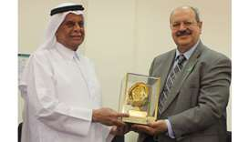 HE Abdullah bin Hamad al-Attiyah being honoured by Dr Riadh Fadhil.