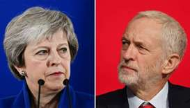 Britain's Prime Minister Theresa May (L)  and Britain's opposition Labour Party leader Jeremy Corbyn