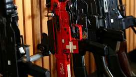 A rifle with a Swiss flag is pictured