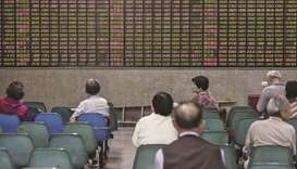 Asia markets mostly rise but Huawei, trade war loom large