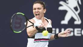 'Happy' Halep feeling less pressure