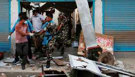 Security personnel carry a victim's body after an explosion in Kathmandu