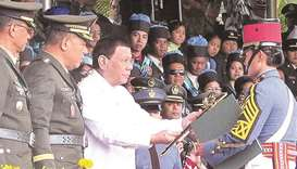 Duterte urges academy grads to be good soldiers amid 'dangers'
