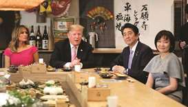 Trump, Abe bond over burgers, sumo and golf
