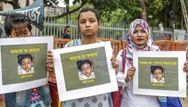 Bangladeshi women hold placards and photographs of schoolgirl Nusrat Jahan Rafi at a protest in Dhak
