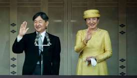 Japan's Emperor Naruhito (L) and Empress Masako (R) make their first public appearance after ascendi