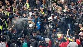 French police apprehend protesters during the traditional May Day labour union march with French uni