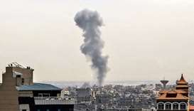 Smoke billows above buildings in Rafah in the southern Gaza Strip during an Israeli airstrike on the