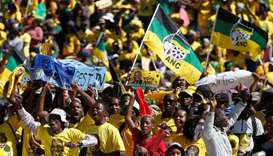 Supporters of South Africa's governing African National Congress carry a mock coffin of the oppositi