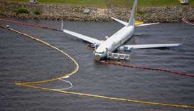 The containment and absorbent booms surroundng a Boeing 737 aircraft in the St. Johns River after th