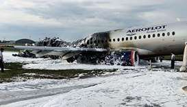 destroyed fuselage at a site of a fire of a Russian-made Superjet-100 at Sheremetyevo airport outsid