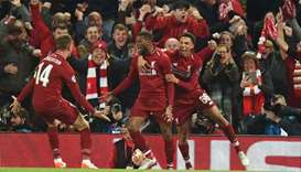 Liverpool's Dutch midfielder Georginio Wijnaldum (C) celebrates with Liverpool's English midfielder