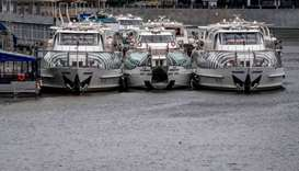 Pleasure yachts stand on the pier on Moskva river in central Moscow on May 10, 2020, during a strict