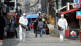 Quarantine workers spray disinfectants at night spots of Itaewon neighborhood, following the coronav