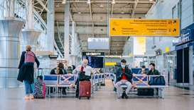 Passengers of a flight to Nur-Sultan wait before boarding a plane at Almaty International Airport, K