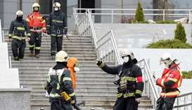 Emergency specialists work on a site of fire, that killed five novel coronavirus patients in an inte