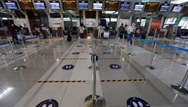 A view shows social distancing marks on the floor at the check-in counters of the Soekarno-Hatta Int