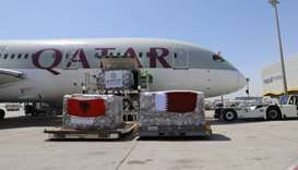 The aid shipment to Albania being loaded on to a Qatar Airways aircraft.