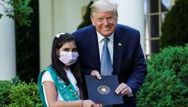 US President Donald Trump poses with girl scout Laila Khan of Troop 744 in Elkridge, Maryland after