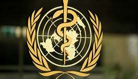 The World Health Organization (WHO) logo is pictured at the entrance of its headquarters in Geneva,