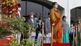 Nepal President Bidhya Devi Bhandari wearing a protective face mask reviews a guard of honour as she