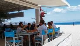 People have lunch at a beach bar and restaurant in the Son Matias beach during the coronavirus disea