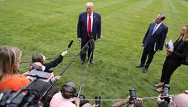 US President Donald Trump talks to reporters while US Health and Human Services (HHS) Secretary Alex