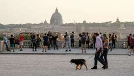 People walk on the Pincio Terrace at Villa Borghese park, in central Rome
