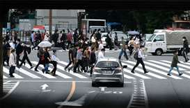 Pedestrians walk on a crossing in Tokyo, Japan