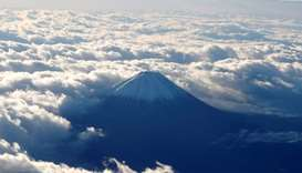 Mount Fuji is seen from a plane in Japan
