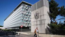 Mike Ryan, Executive Director of the World Health Organization (WHO), walks past the headquarters of