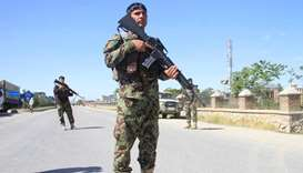 Afghan National Army officers stand guard at the site of a blast in Ghazni province, Afghanistan
