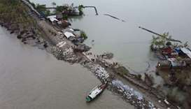 An aerial view shows volunteers and residents working to fix a damaged dam following the landfall of