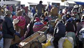 Locals from El Alto, Bolivia, visit a street market despite restrictions banning crowded places rega