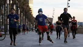 People exercise at the Barceloneta beach during the hours in which individual exercise is allowed ou