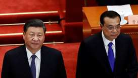 Chinese President Xi Jinping and Premier Li Keqiang arrive for the opening session of the Chinese Pe