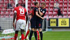 Leipzig's German forward Timo Werner (right) celebrates with  Leipzig's Slovenian midfielder Kevin K