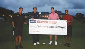 Tiger Woods (right) and former NFL player Peyton Manning (second right) celebrate defeating Phil Mic