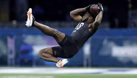 Defensive back Noah Igbinoghene of Auburn runs a drill during the NFL Combine at Lucas Oil Stadium
