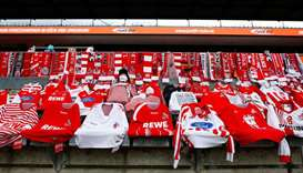 Jerseys and scarves are seen in the stands before the Bundesliga match between FC Cologne vs Fortuna