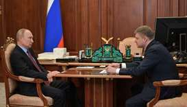 Russian President Vladimir Putin (L) speaks with with Russian Railways CEO Oleg Belozyorov during th