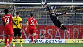 Dortmund's goalkeeper Roman Buerki fails to keep out the goal scored by Bayern Munich's midfielder J