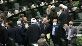 Iranian lawmakers attend the opening ceremony of Iran's 11th parliament, as the spread of the corona