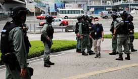 Riot police officers stand guard outside Central Government Complex as a second reading of a controv