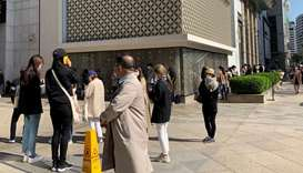 People queue to enter the Chanel boutique at a department store amid the coronavirus disease outbrea