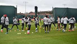 In this March 10, 2020, picture, Liverpool players attend a training session at Melwood in Liverpool