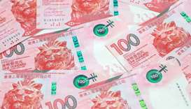 Hong Kong dollar banknotes are seen in an arranged photograph. The Hong Kong dollar's recent strengt